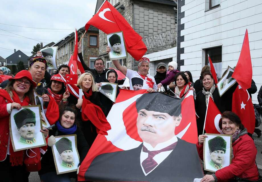 LIEGE, BELGIUM - FEBRUARY 27: People hold posters of Turkish Republic's founder Mustafa Kemal Ataturk and Turkish flags as they take part in the annual Faymonville Carnival in the Faymonville village of Liege, Belgium on February 27, 2017. The Belgian village of Faymonville has been called as a Turkish village for centuries. (Photo by Dursun Aydemir/Anadolu Agency/Getty Images) Photo: Anadolu Agency/Getty Images