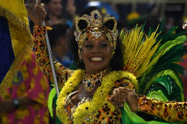 A reveller of the Paraiso do Tuiuti samba school performs during the first night of Carnival parades at the Sambadrome in Rio de Janeiro on February 26, 2017.                AFP /VANDERLEI ALMEIDA / AFP / VANDERLEI ALMEIDA        (Photo credit should read VANDERLEI ALMEIDA/AFP/Getty Images)