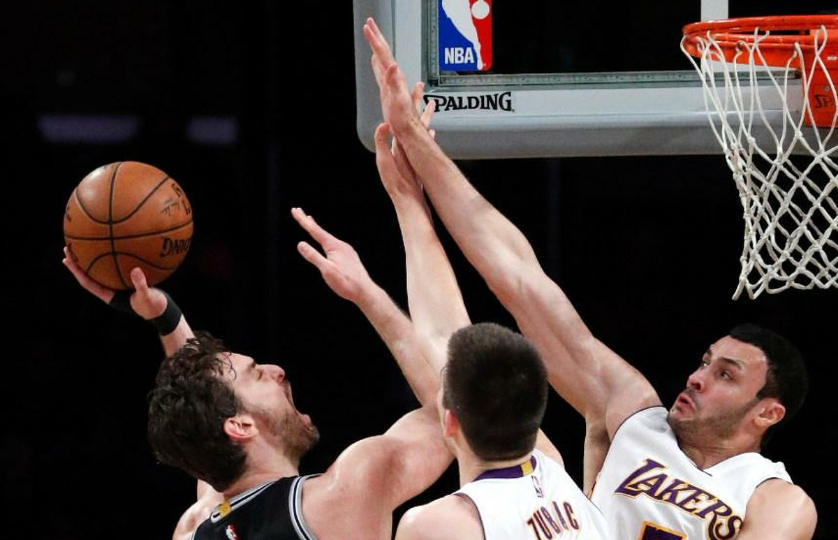 San Antonio Spurs center Pau Gasol, left, is defended by Los Angeles Lakers' Ivica Zubac and Larry Nance Jr., right, during the Spurs victory Feb. 26, 2017, in Los Angeles.