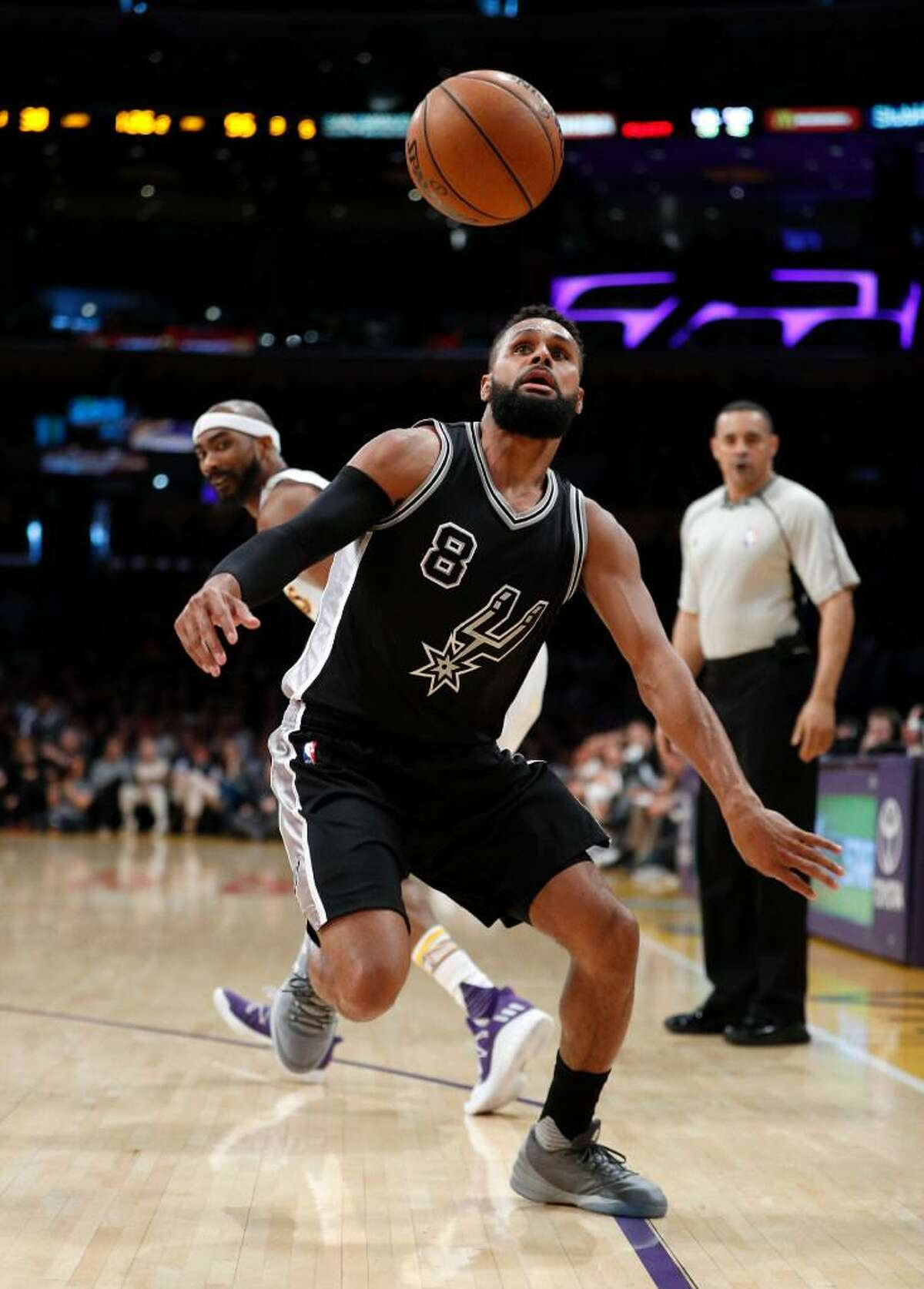 Spurs guard Patty Mills goes after the ball during San Antonio's 119-98 victory over the Los Angeles Lakers on Feb. 26, 2017, in Los Angeles.