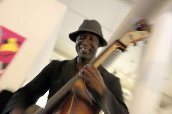 Marcus Shelby plays bass in 2010