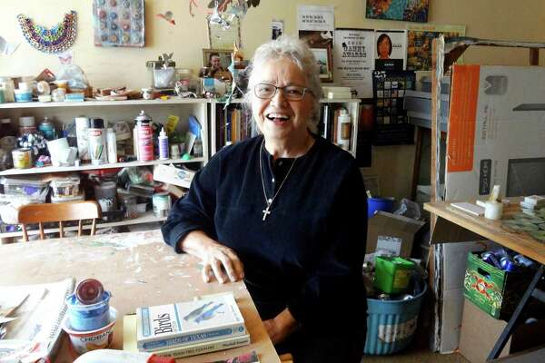 Anita Valencia makes her art from recycled materials in an upstairs bedroom that once belonged to her three daughters as they grew up in her house on Woodlawn Lake.