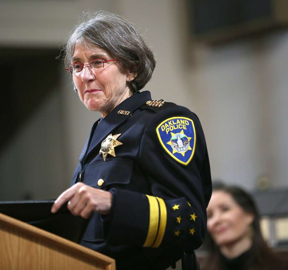 Anne Kirkpatrick (left) talks after being sworn in as Oakland's permanent police chief of Police at an Oakland City Hall ceremony Feb. 27. Her response to an August operation by federal agents has been criticized by a city commissioner and several City Council members. Photo: Liz Hafalia, The Chronicle