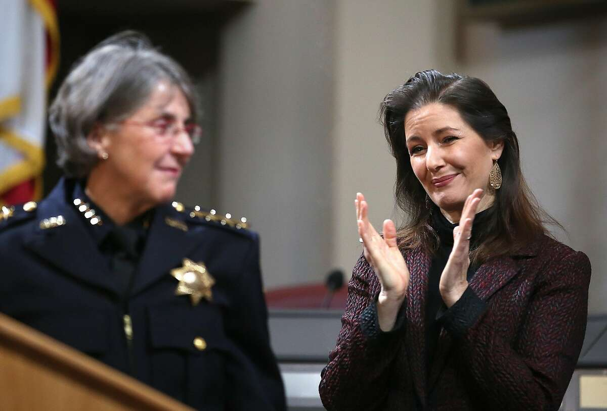 Mayor Libby Schaaf (right) claps after Anne Kirkpatrick's speech at an Oakland City Hall ceremony on February 27, 2017.