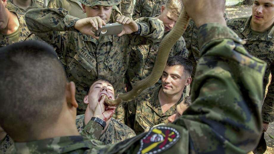 """Snake Eaters!#Marines drink cobra blood during #CobraGold17 at Camp Ban Chan Krem, Thailand. Troops can use cobra blood and flesh as nutrition where sustenance is scarce."" Photo: Courtesy/Facebook"