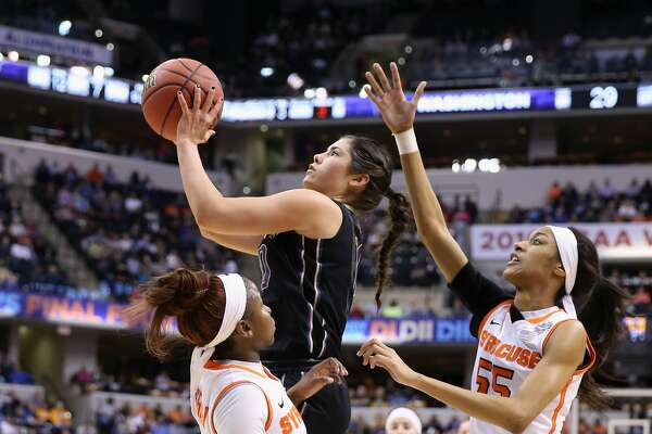INDIANAPOLIS, IN - APRIL 03:  Kelsey Plum #10 of the Washington Huskies shoots against Julia Chandler #3 and Bria Day #55 of the Syracuse Orange in the first quarter during the semifinals of the 2016 NCAA Women's Final Four Basketball Championship at Bankers Life Fieldhouse on April 3, 2016 in Indianapolis, Indiana.  (Photo by Andy Lyons/Getty Images)