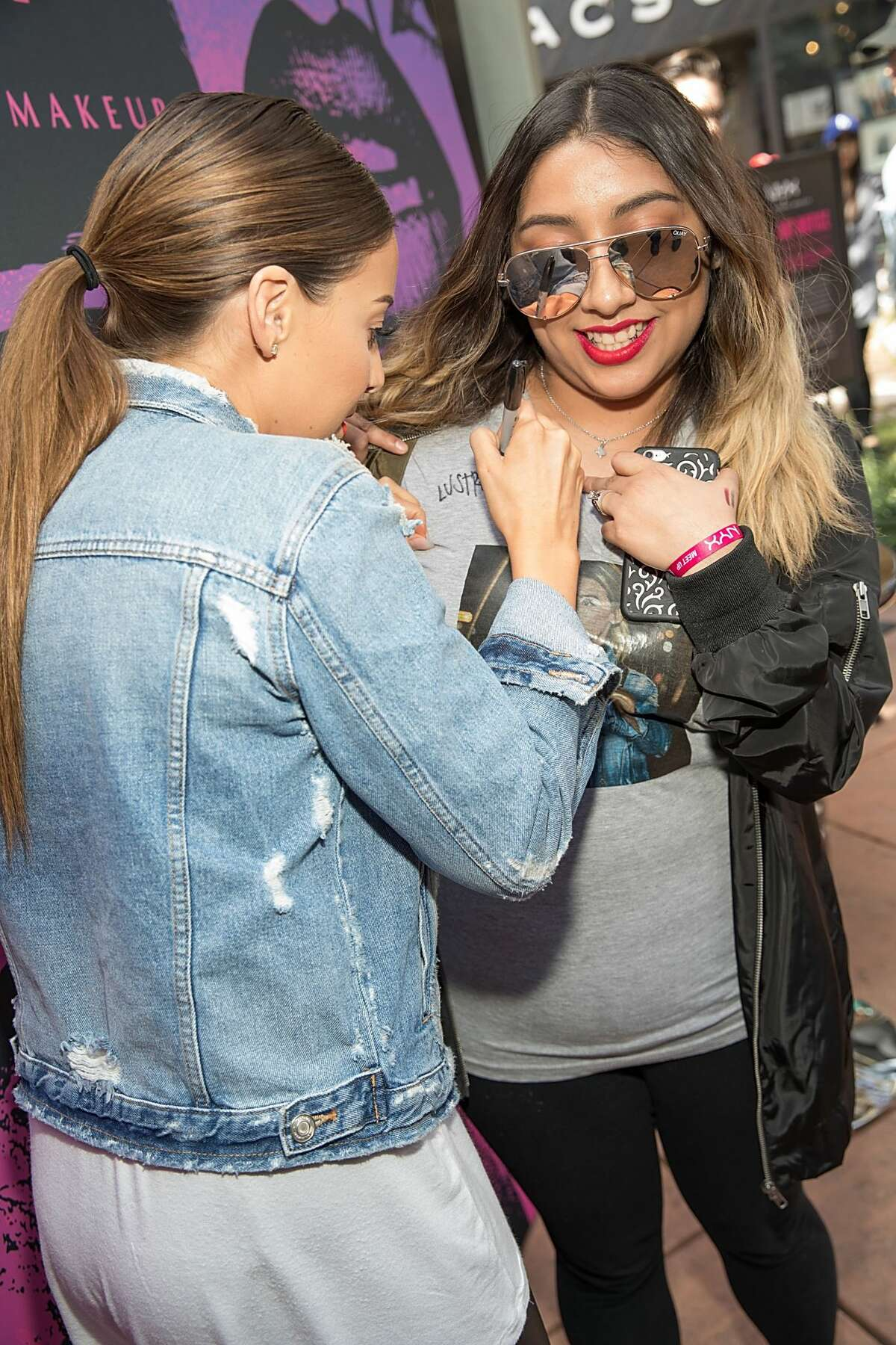 SAN ANTONIO, TX - FEBRUARY 25: Lustrelux @lustrelux (L) greets fans during the NYX Professional Makeup Store Grand Opening Meet & Greet at The Shops at La Cantera on February 25, 2017 in San Antonio, Texas. (Photo by Rick Kern/Getty Images for NYX Professional Makeup)