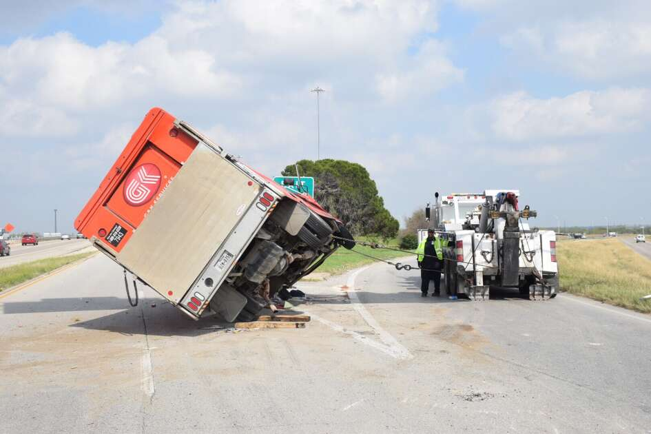 Traffic on Interstate 35 was slowed down Monday, Feb. 27, 2017, after a delivery truck driver drove over a barrier and flipped his truck.