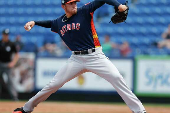 Houston Astros starting pitcher Joe Musgrove (59) works in the first inning of a spring training baseball game against the New York Mets Monday, Feb. 27, 2017 in Port St. Lucie, Fla. (AP Photo/John Bazemore)