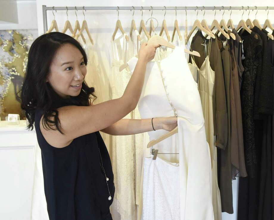 Greenwich native Katie Fong shows trendy bridalwear for the upcoming wedding season at her couture gown and dress shop in Greenwich, Conn. Tuesday, Feb. 21, 2017. Photo: Tyler Sizemore / Hearst Connecticut Media / Greenwich Time