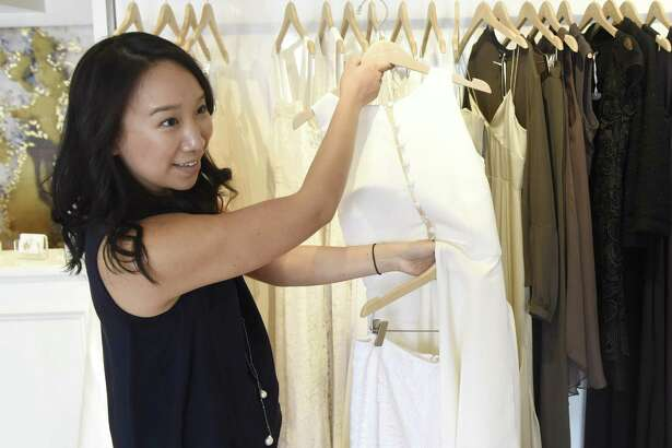 Greenwich native Katie Fong shows trendy bridalwear for the upcoming wedding season at her couture gown and dress shop in Greenwich, Conn. Tuesday, Feb. 21, 2017.