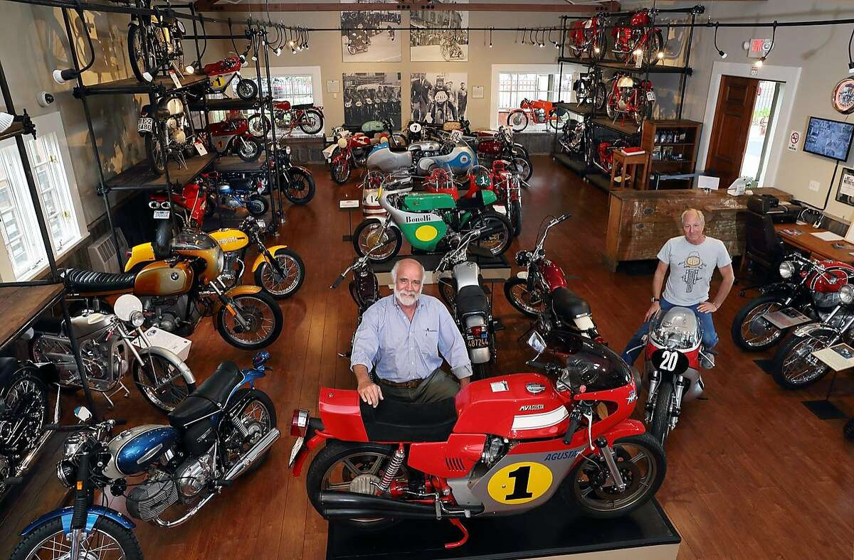 Robert Talbott (left) and Bobby Weindorf inside new Moto Talbott Collection museum in Monterey.