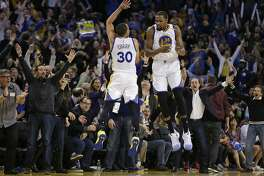 Golden State Warriors' Stephen Curry (30) and Kevin Durant (35) celebrate a score against the Los Angeles Clippers during the second half of an NBA basketball game Thursday, Feb. 23, 2017, in Oakland, Calif. (AP Photo/Ben Margot)