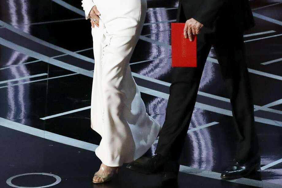 """Warren Beatty carries an envelope reading """"Actress in a Leading Role"""" as he walks on stage with Faye Dunaway to present the Oscar for Best Picture during the 89th Academy Awards at the Dolby Theatre. Photo: PATRICK T. FALLON, NYT"""