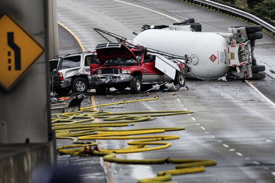 A flammable propane tanker truck rolled over on Interstate 5 Monday morning, causing a midday shutdown of I-5 and Interstate 90 in downtown Seattle. Three people suffered minor injuries. Photo: Grant Hindsley/seattlepi.com