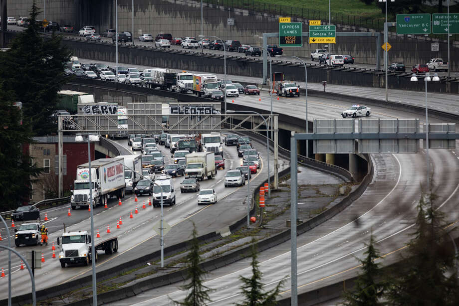 A flammable butane tanker truck rolled over on Interstate 5 Monday morning, causing a midday shutdown of I-5 and Interstate 90 in downtown Seattle. Three people suffered minor injuries. Photo: Grant Hindsley/seattlepi.com