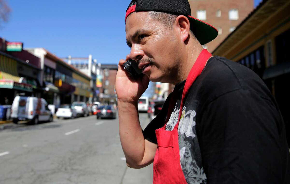Ruben Rosales makes a call on Telegraph Avenue. Berkeley settled with the wireless industry for now.