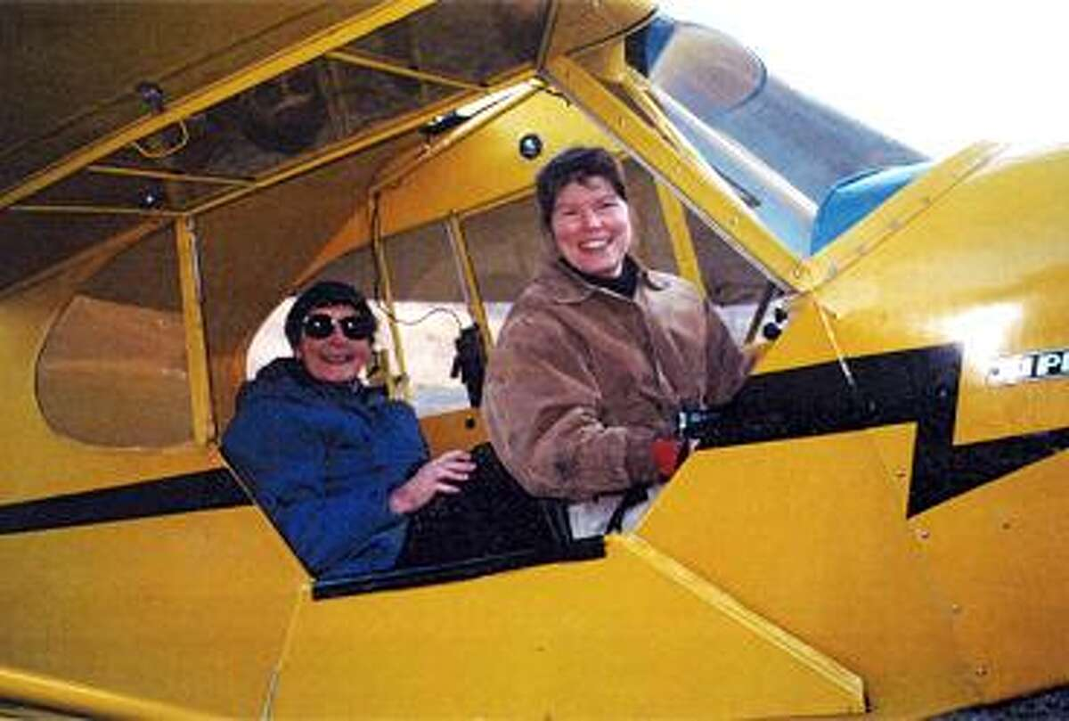 Lonni Sue Johnson is shown in her airplane with her mother in back.