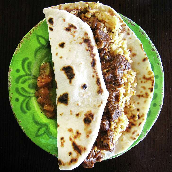 """A """"Texas Size"""" carne con chile with rice taco on a handmade flour tortilla from Roy's Taco Hut on Old Highway 90 West."""