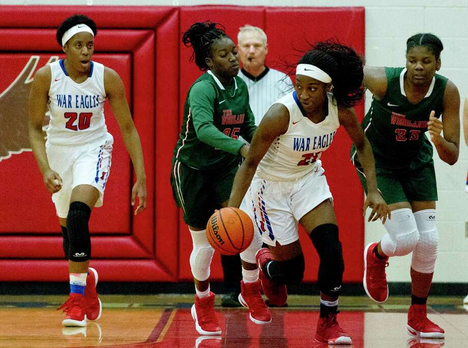 Oak Ridge guard Alecia Whyte (21) starts a fast break during the second quarter of a District 12-6A high school girls basketball game at Oak Ridge High School Tuesday, Jan. 17, 2017, in Conroe. Oak Ridge defeated The Woodlands 66-36. Photo: Jason Fochtman, Staff Photographer / © 2017 Houston Chronicle