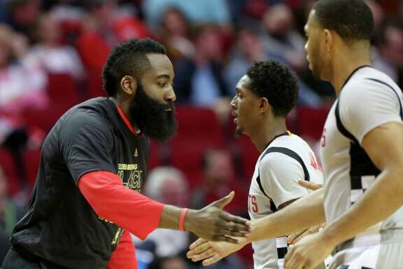 Houston Rockets guard James Harden (13) cheers with Lou Williams (12) and Eric Gordon (10) during the second half of the game at Toyota Center Saturday, Feb. 25, 2017, in Houston. ( Yi-Chin Lee / Houston Chronicle )