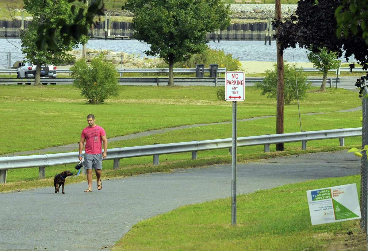 Brian Fama of Stamford walks his dog Wall-E on Thursday, Sept. 29, 2016. The city held the first public input session Tuesday night for the Boccuzzi Park Master Plan. The city has hired Hamden-based Stantec Consulting to come up with design alternatives for the park within the next year.