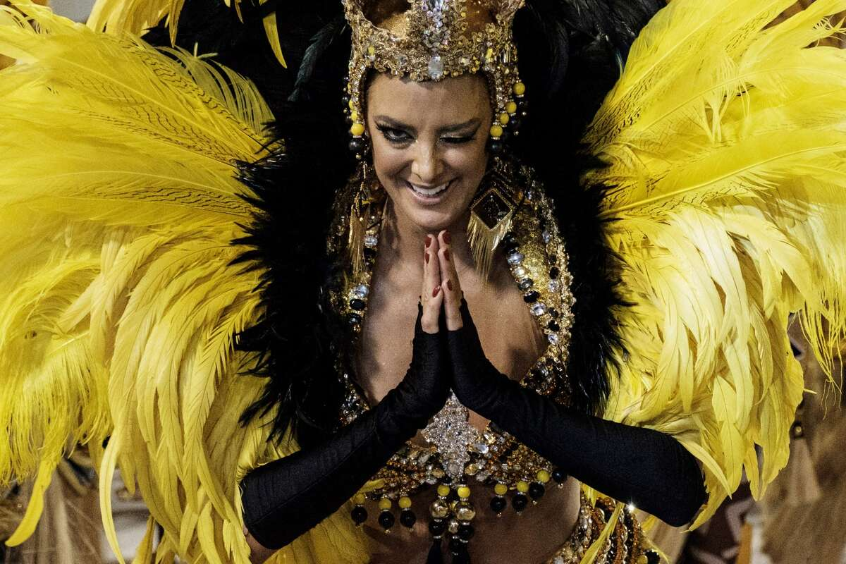 A reveller of the Unidos de Vila Isabel samba school performs during the first night of Rio's Carnival at the Sambadrome in Rio de Janeiro, Brazil, early on February 27, 2017.