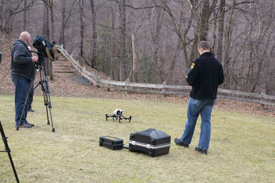 Employees from the Albany County Sheriff's Office prepare to use a drone to help Troy police search the Poesten Kill gorge for a man who vanished over the weekend. (Bob Gardinier / Special to the Times Union)