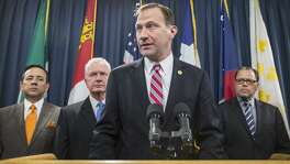 State Sen. Charles Schwertner, R-Georgetown, (center) has introduced legislation to make Texas nursing homes more accountable. Here, he speaks on infectious diseases in Texas.