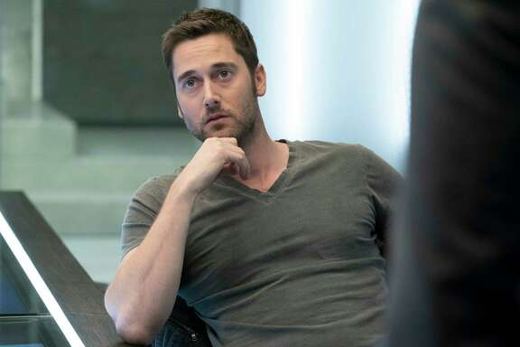 """This image released by NBC shows Ryan Eggold as Tom Keen in a scene from """"The Blacklist: Redemption."""" (Virginia Sherwood/NBC via AP)"""