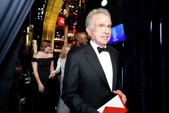 """Warren Beatty leaves the stage after the announcement of the Oscar for Best Picture during the 89th Academy Awards at the Dolby Theatre in Los Angeles, Feb. 26, 2017. Beatty and Faye Dunaway announced """"La La Land,"""" but """"Moonlight"""" was the correct winner. (Monica Almeida/The New York Times)"""