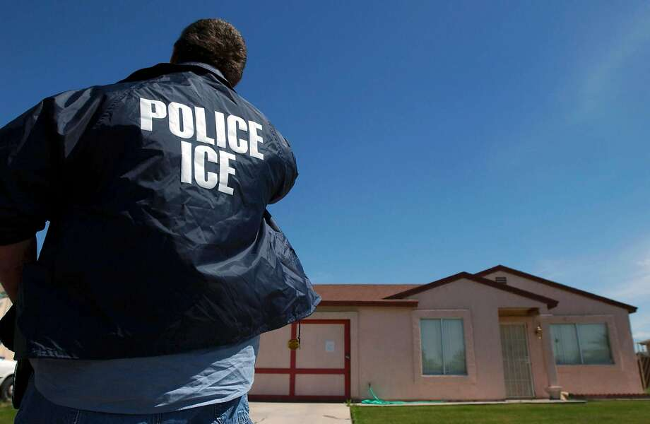FILE � An Immigration and Customs Enforcement officer outside a home where a tunnel under the border was recently found, in Calexico, Calif., March 21, 2005. Enthusiasm for the Trump administration�s policy on deportations is high among ICE agents, many of whom chafed under the Obama administration�s mandate to focus on gang members and other serious criminals. (Ann Johansson/The New York Times) Photo: ANN JOHANSSON, NYT