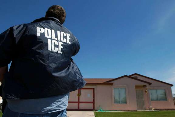 FILE � An Immigration and Customs Enforcement officer outside a home where a tunnel under the border was recently found, in Calexico, Calif., March 21, 2005. Enthusiasm for the Trump administration�s policy on deportations is high among ICE agents, many of whom chafed under the Obama administration�s mandate to focus on gang members and other serious criminals. (Ann Johansson/The New York Times)