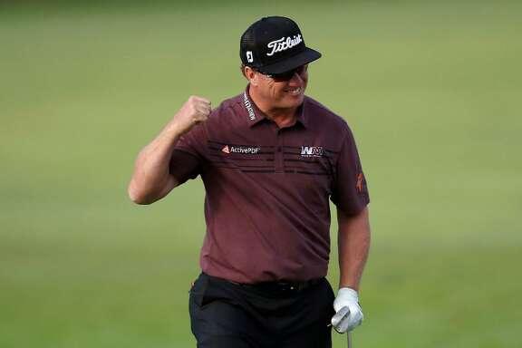 Charley Hoffman reacts after chipping in to save par on the 15th hole during the final round of the Genesis Open golf tournament at Riviera Country Club Sunday, Feb. 19, 2017, in the Pacific Palisades area of Los Angeles.