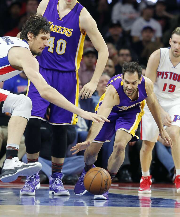 Detroit Pistons center Boban Marjanovic, left, and Los Angeles Lakers guard Jose Calderon reach for the loose ball during the second half of an NBA basketball game, Wednesday, Feb. 8, 2017, in Auburn Hills, Mich. (AP Photo/Carlos Osorio) Photo: Carlos Osorio, Associated Press