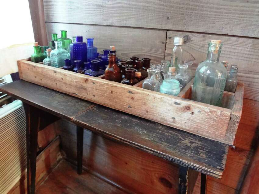 Marilyn Lanfear is a collector of many things, including antique glass poison bottles.