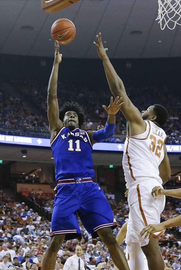 Freshman guard Josh Jackson shoots over Texas' Shaquille Cleare on Saturday in Kansas' Big 12 road victory. Photo: Chris Covatta, Getty Images
