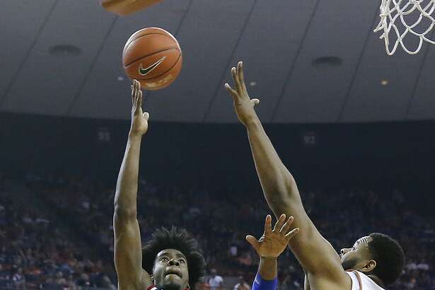 AUSTIN, TX - FEBRUARY 25: Josh Jackson #11 of the Kansas Jayhawks shoots over Shaquille Cleare #32 of the Texas Longhorns at the Frank Erwin Center on February 25, 2017 in Austin, Texas. (Photo by Chris Covatta/Getty Images)