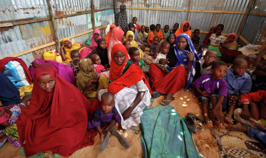 Displaced girls who fled the drought in southern Somalia wait in line to receive food at a camp in Mogadishu. (AP Photo/Farah Abdi Warsameh) Photo: Farah Abdi Warsameh, STR / Copyright 2017 The Associated Press. All rights reserved.