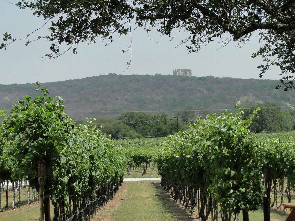 Falkenstein Castle, a wedding venue, is visible from the vineyards at Perissos Vineyard and Winery on Park Road 4 near Kingsland, Texas.