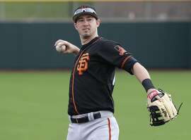 San Francisco Giants' Trevor Brown warms up during spring training baseball workouts, Friday, Feb. 17, 2017, in Scottsdale, Ariz. (AP Photo/Matt York)
