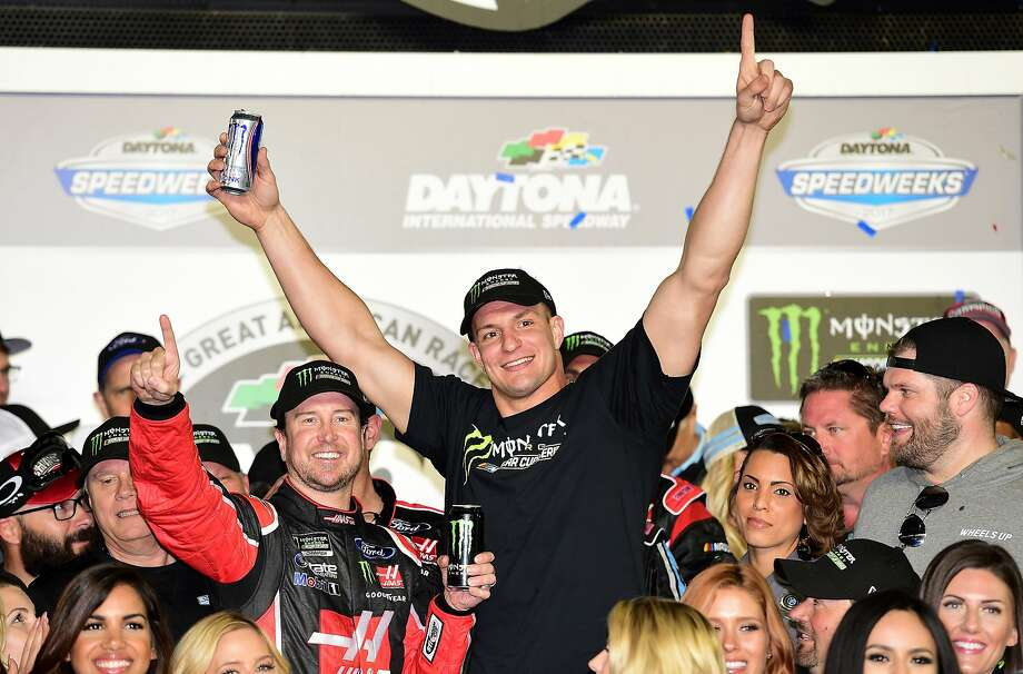 DAYTONA BEACH, FL - FEBRUARY 26:  Kurt Busch, driver of the #41 Haas Automation/Monster Energy Ford, celebrates in Victory Lane with New England Patriots tight end Rob Gronkowski after winning the 59th Annual DAYTONA 500 at Daytona International Speedway on February 26, 2017 in Daytona Beach, Florida.  (Photo by Jared C. Tilton/Getty Images) Photo: Jared C. Tilton, Getty Images