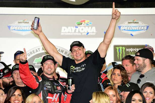 DAYTONA BEACH, FL - FEBRUARY 26:  Kurt Busch, driver of the #41 Haas Automation/Monster Energy Ford, celebrates in Victory Lane with New England Patriots tight end Rob Gronkowski after winning the 59th Annual DAYTONA 500 at Daytona International Speedway on February 26, 2017 in Daytona Beach, Florida.  (Photo by Jared C. Tilton/Getty Images)