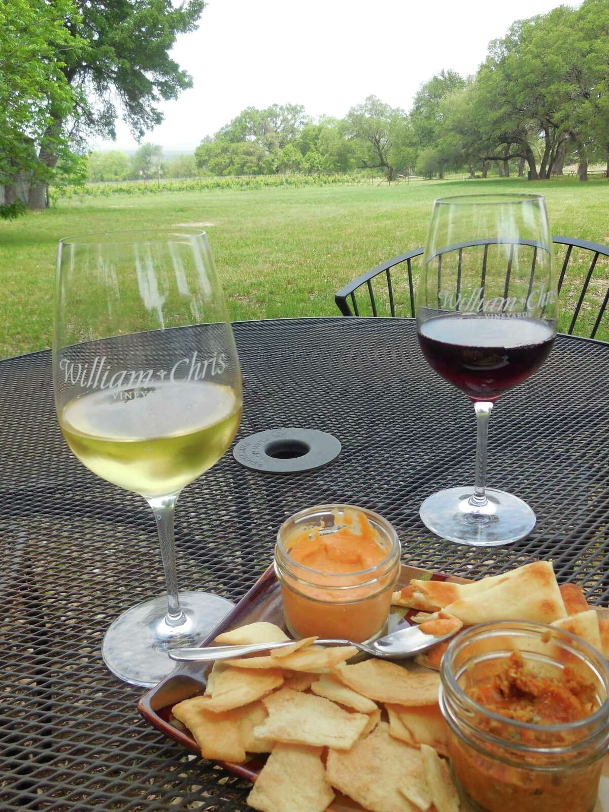 Tables on the lawn at William Chris Vineyards give guests a chance to enjoy snacks with wine from the Vineyards in Hye, on U.S. 290 between Johnson City and Fredericksburg.