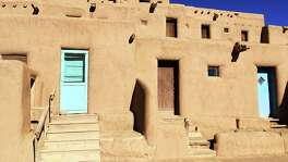 Visitors are free to roam Taos Pueblo, with multi-storied adobe buildings that have been continuously inhabited for more than 1,000 years.