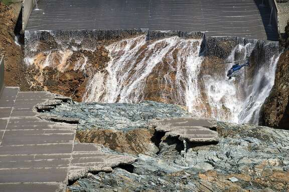 Oroville Dam's crippled spillway is inspected via helicopter after it was shut off Monday, Feb. 27, 2017, in Oroville, Calif. (Paul Kitagaki Jr./The Sacramento Bee via AP)