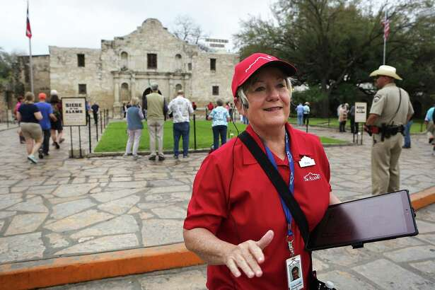 """Shiela Skipper, a tour guide at the Alamo, gives a tour to staff members using new equipment and training curriculum which will be put in place on March 4.  The Alamo will also open it's new exhibit, """"Bowie: Man-Knife-Legend""""."""