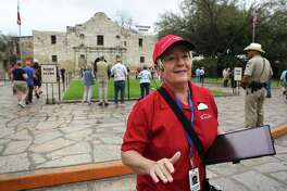 "Shiela Skipper, a tour guide at the Alamo, gives a tour to staff members using new equipment and training curriculum which will be put in place on March 4.  The Alamo will also open it's new exhibit, ""Bowie: Man-Knife-Legend""."