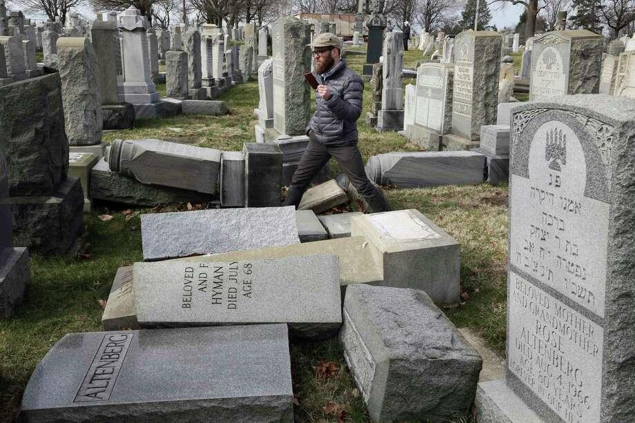 Rabbi Joshua Bolton of the University of Pennsylvania's Hillel center surveys damage Monday at Mount Carmel Cemetery in Philadelphia.  Photo: Jacqueline Larma, STF / Copyright 2017 The Associated Press. All rights reserved.