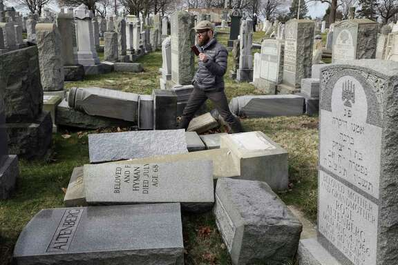 Rabbi Joshua Bolton of the University of Pennsylvania's Hillel center surveys damage Monday at Mount Carmel Cemetery in Philadelphia.